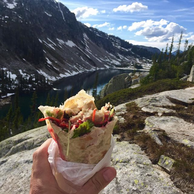 Headed for a hike and need something nutritious and delicious all wrapped into one?! Wegotchu! Friends of TULSI love taking our wraps up the mountain to enjoy in the sun 🌞 Gives them more time on the mountain and less time in the kitchen. Sounds like a win/win to us!  This pic was taken up Kokanee Glacier Provincial Park by one of TULSI's best customers & friends, @thebyronhope