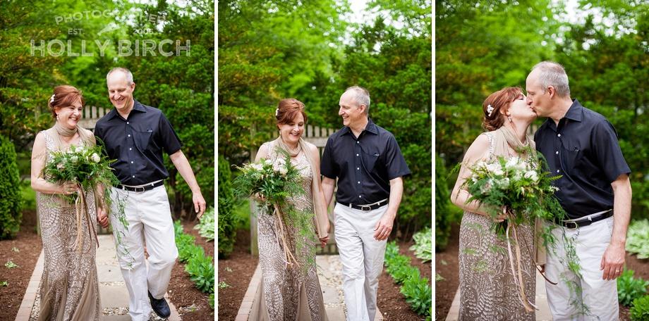 happy couple walking through the garden