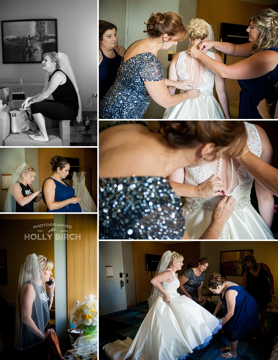 mother of the bride helping button the dress