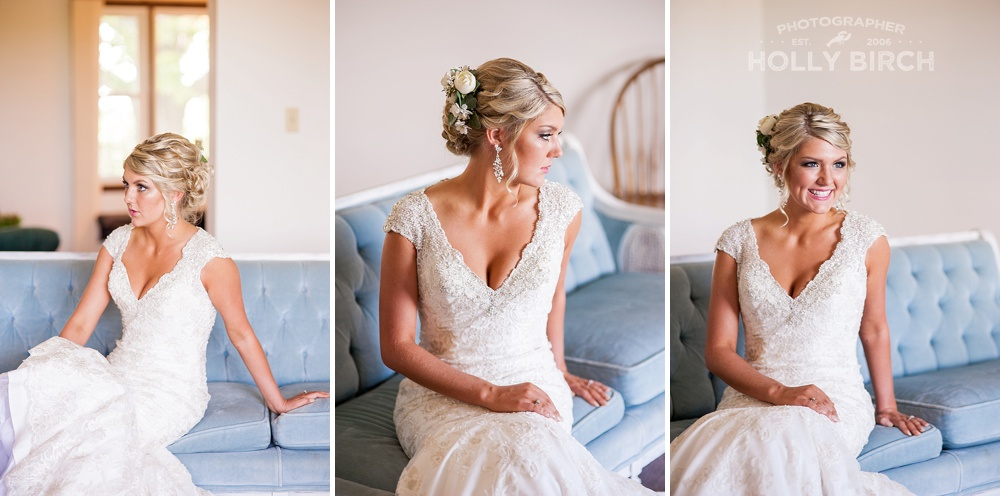 elegant bride sitting on blue upholstered couch