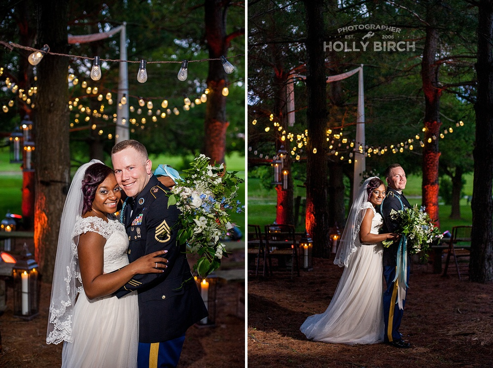 bride and groom pose with tall evergreen trees