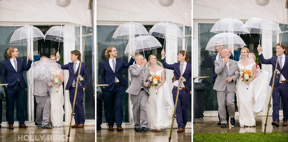 bride enters rainy ceremony with umbrellas