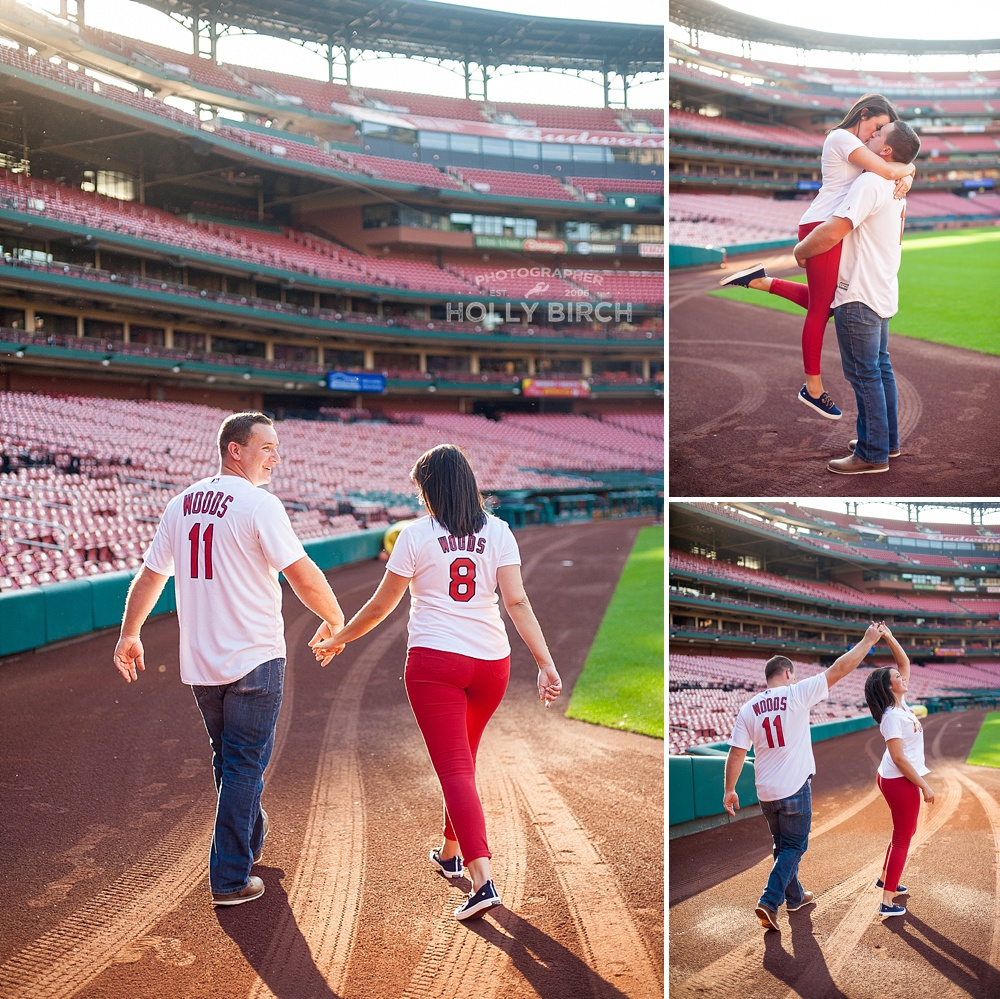 boy picks up girl on Busch stadium field
