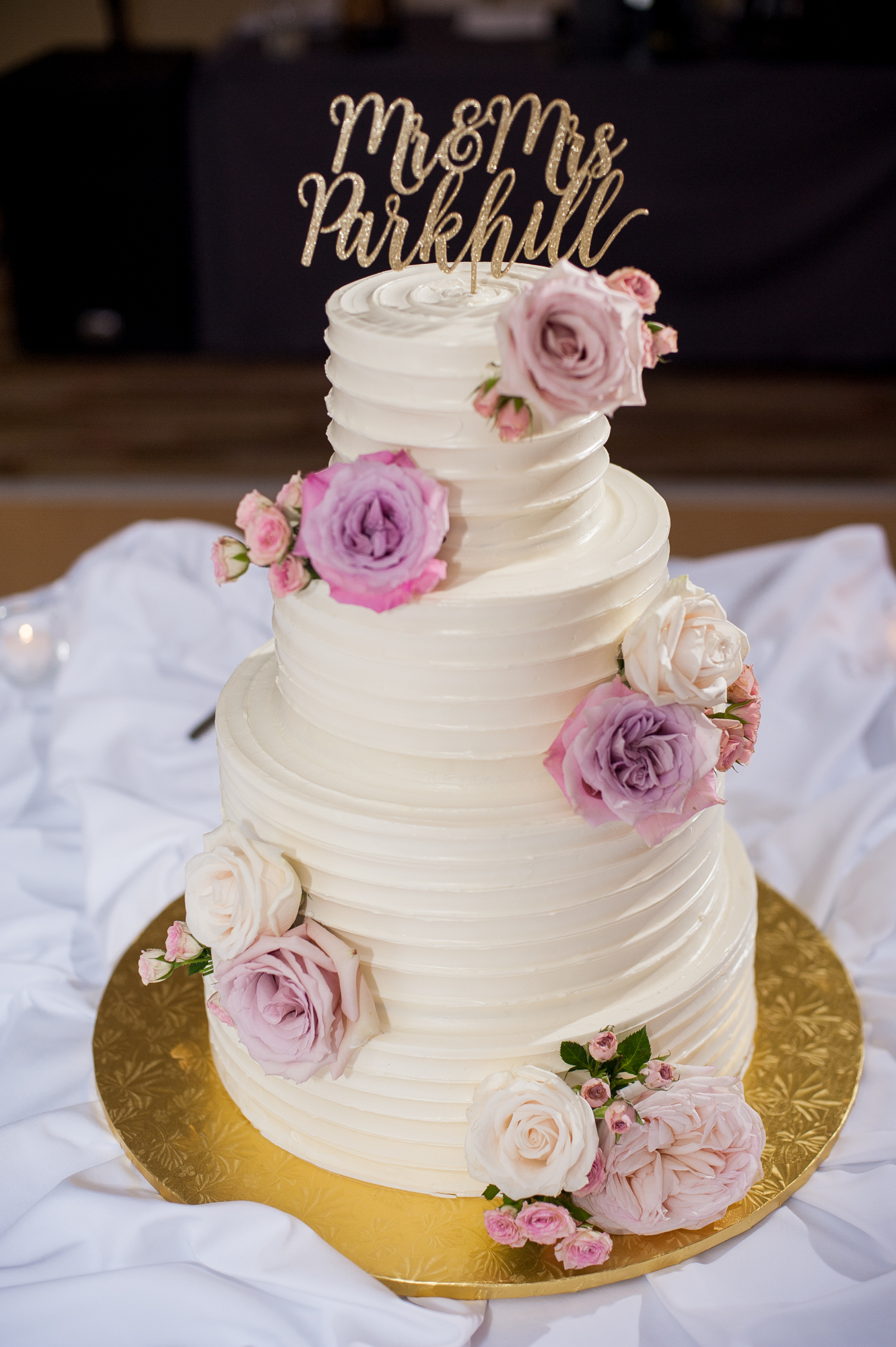 Similar to the first dance photos, I love to cross-light or side-light the cake to really bring out the details and separate the cake from the background or the rest of the room.  This technique works great for cake toppers too that are often the same color as the rest of the decor.