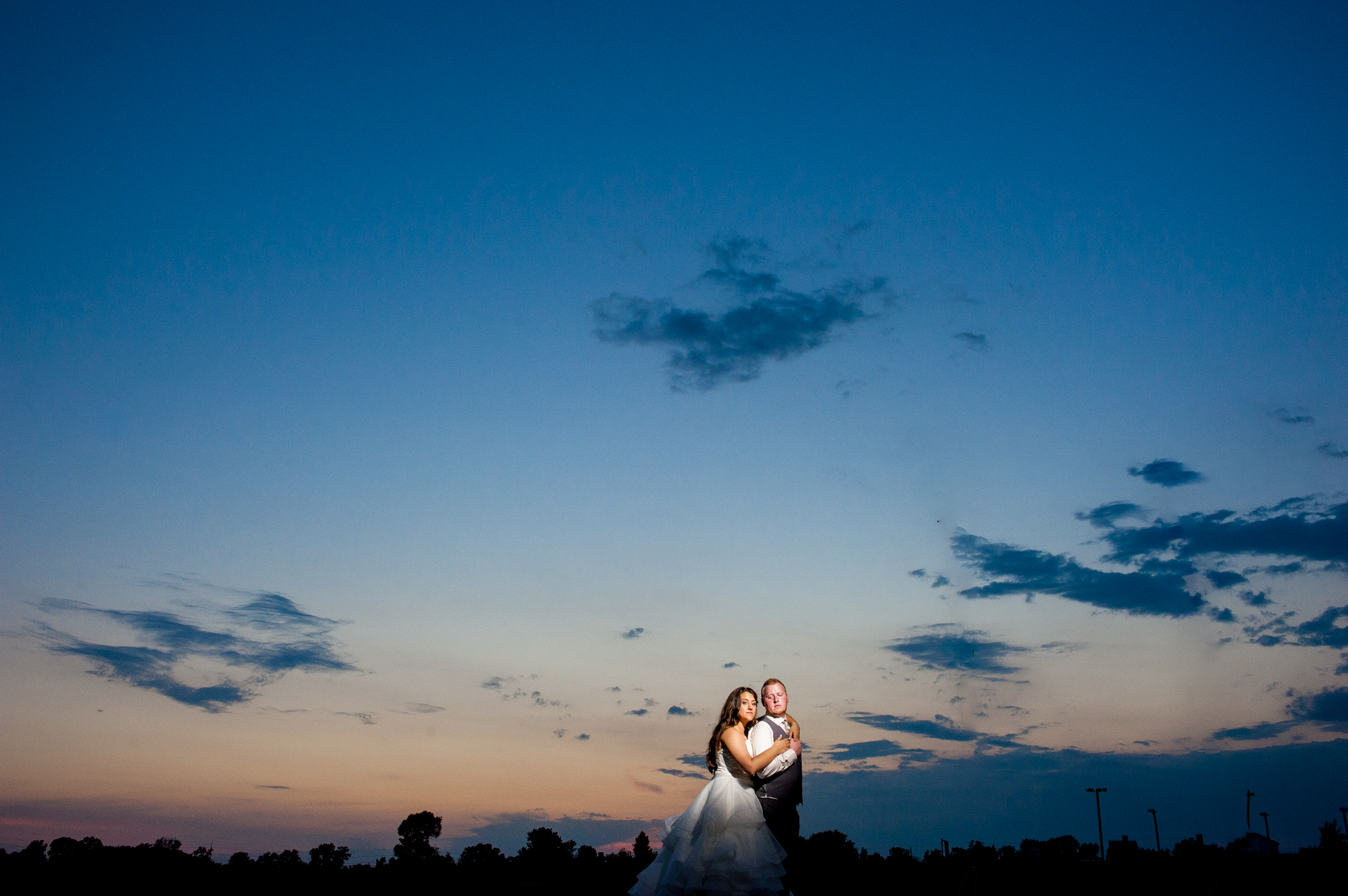 """Off-camera flash also allows you to do more """"big sky"""" type photos because you can get further away from your clients, but your light will still reach them. A few seconds in photoshop to remove the light and voila!"""