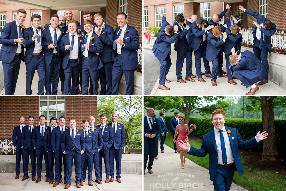 groomsmen in navy suits dabbing