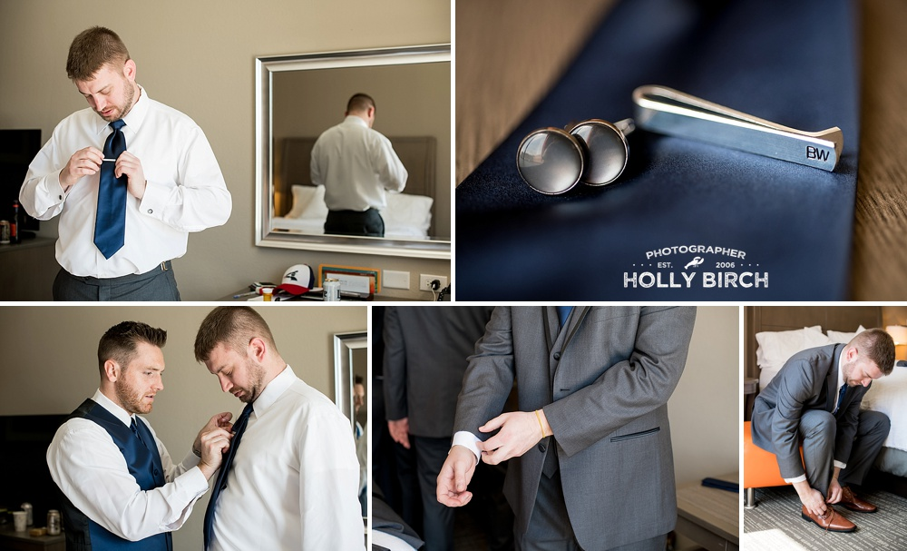 groom getting ready with tie clip