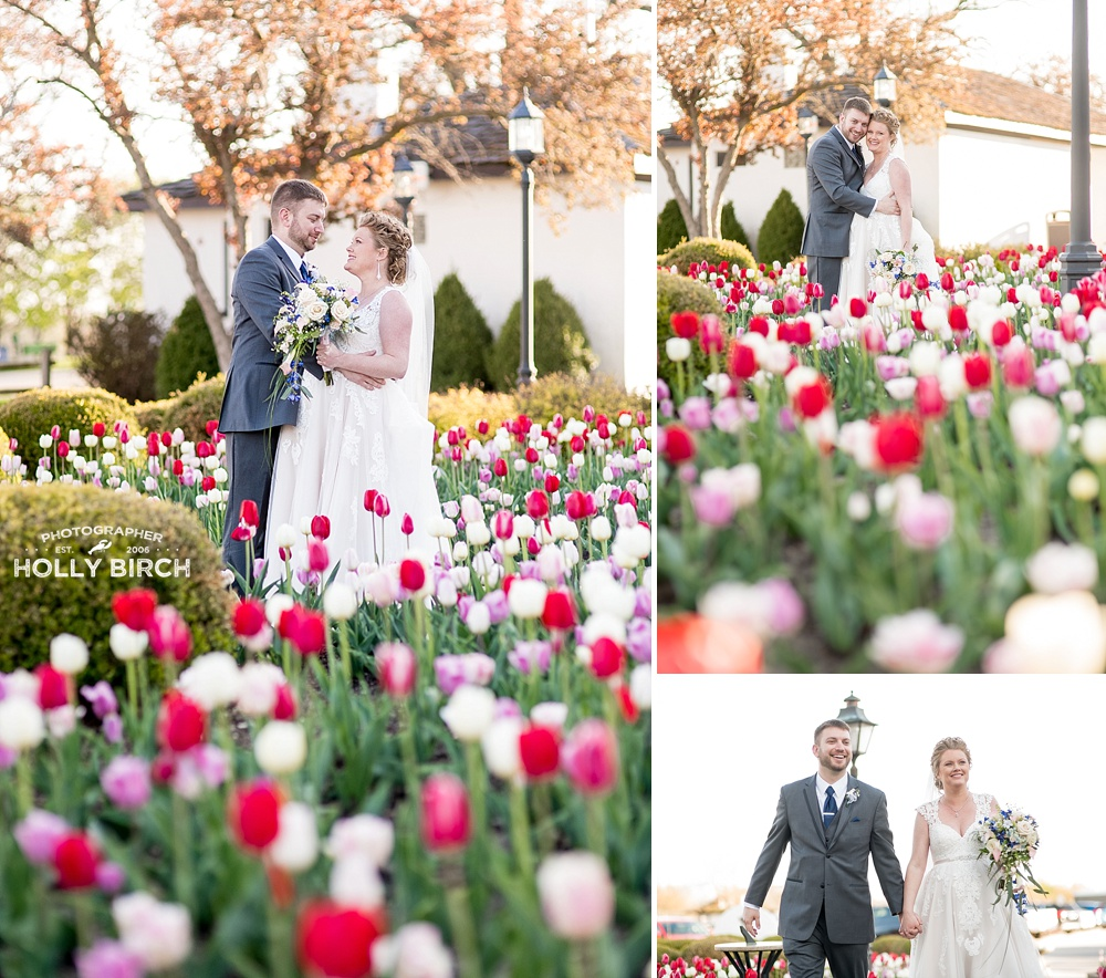 bride and groom among spring tulips