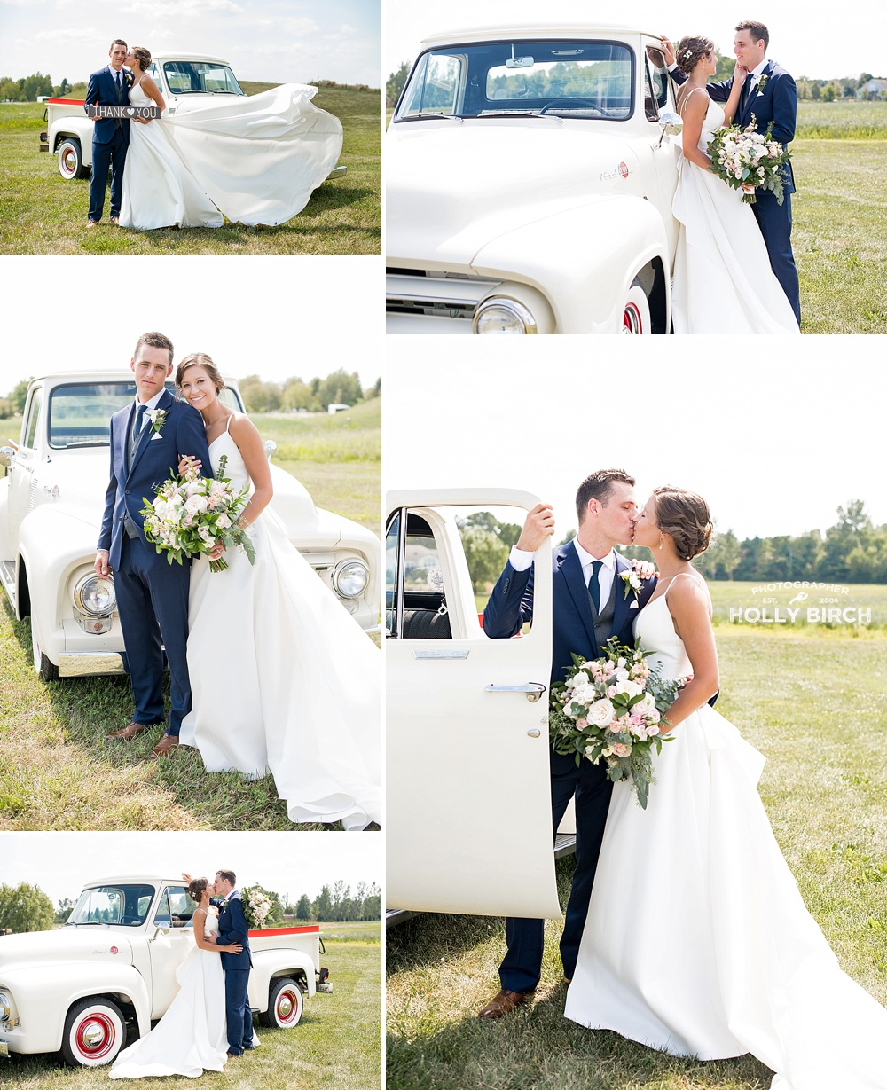 wedding couple poses with antique Ford truck