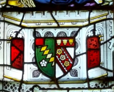 The Knight arms (on the left) - diagonal lozenges with a flower - in stained glass in Chawton church