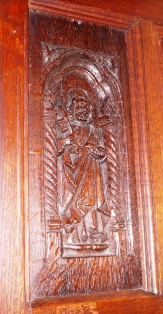 The Greyfriar hidden in the panelling at Chawton House