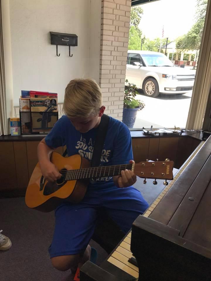 blode dude with guitar.jpg
