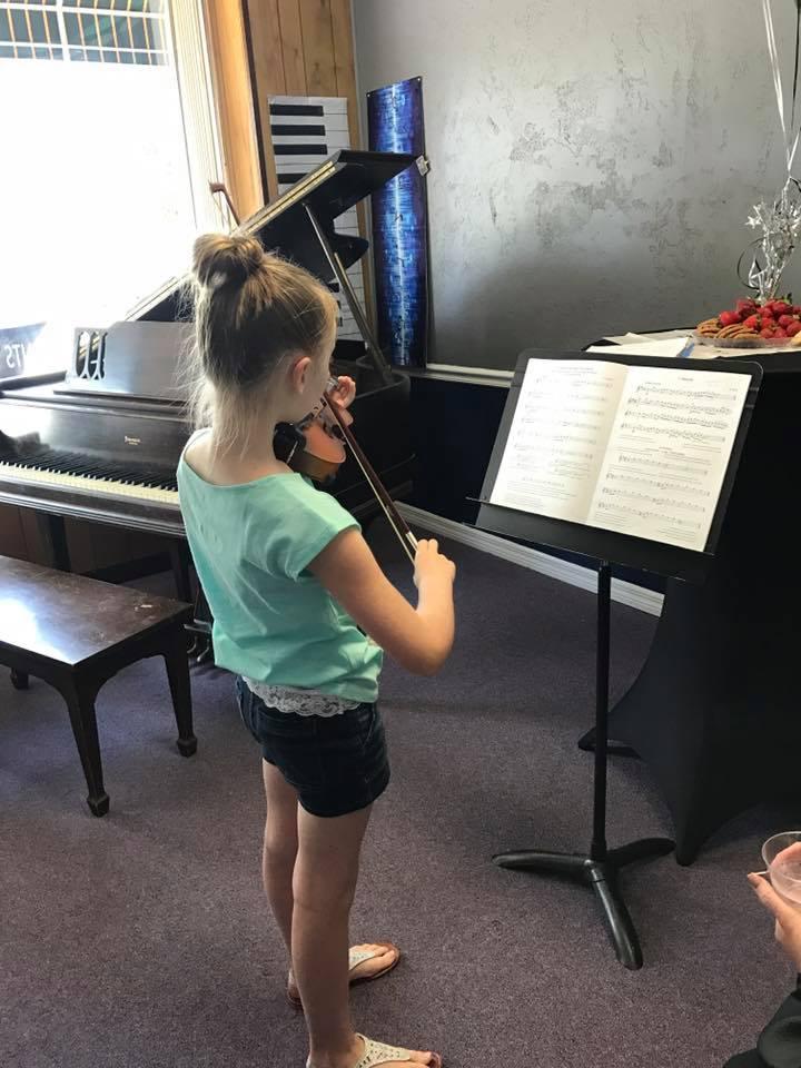 blondy does a violin.jpg
