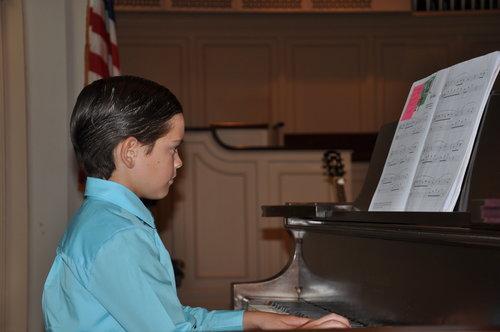 same lil dude shredding the piano.jpeg