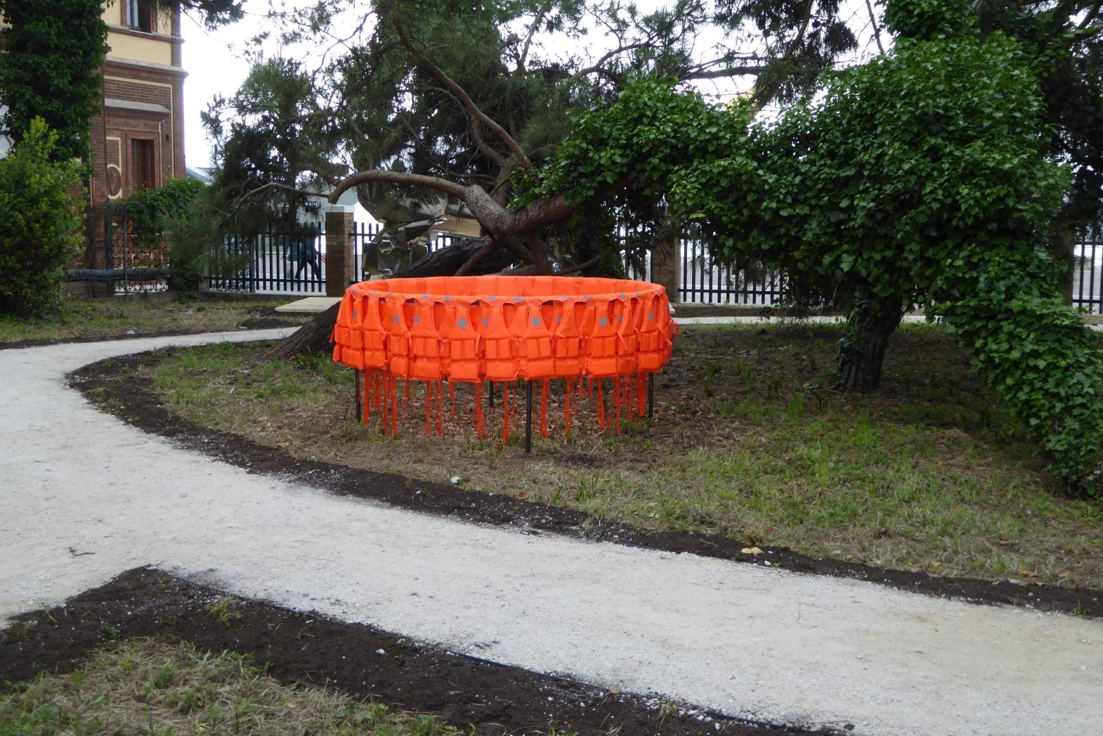 Déplacement (Smuggling Pod), 2017, Life-jackets, Steel, 200 cm diameter x 100 cm, Installation Giardini Marinaressa, Venice ITALY