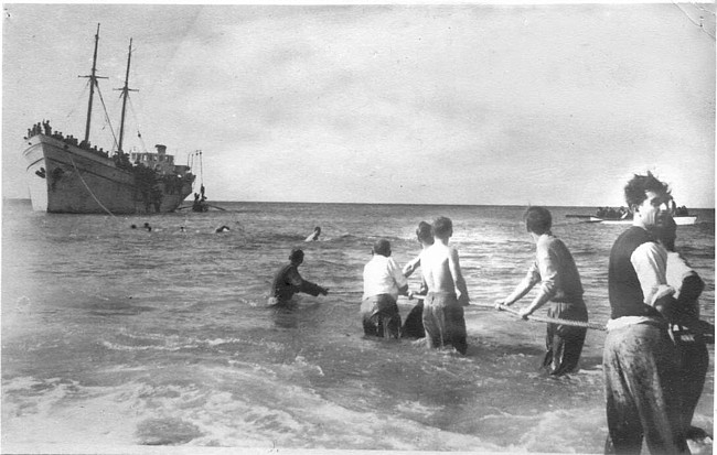 An Aliyah Bet ship unloads Jewish refugees on the beach in Nahariyah, having successful run the British blockade. Photo source: Palyam.org