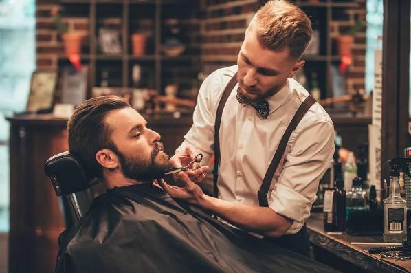 barber trimming men beard hair  chatswood sydney