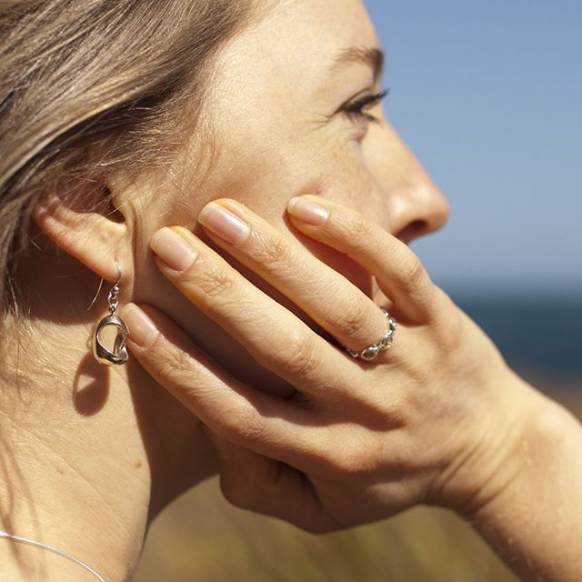 Dreaming that summer will last forever ☀️ ⠀ ⠀ Wearing the Lunar Ring and Cradle Earrings in sterling silver.⠀ #SunKissed #Sun #Forever #ErikaHansenDesign #ErikaHansenJewellery