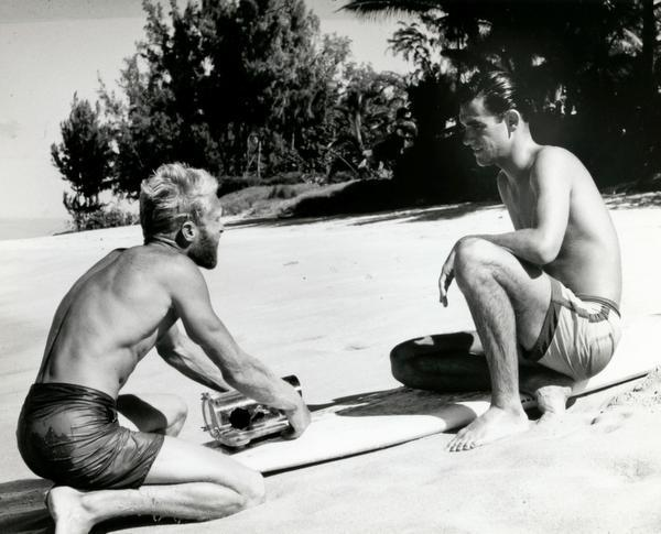 A young Robert August sits with filmmaker Bruce Brown for the movie Endless Summer.