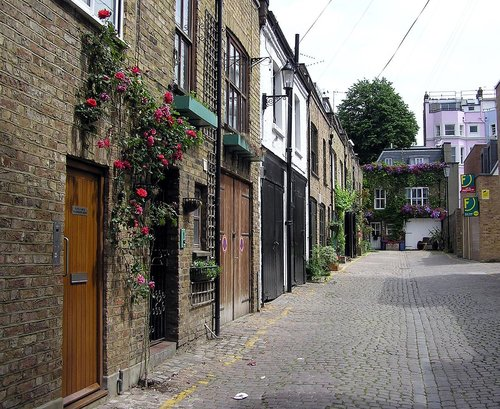 A street of mews houses (Dunworth Mews) in Notting Hill, London, England by Adrian Pingstone -    Image Source