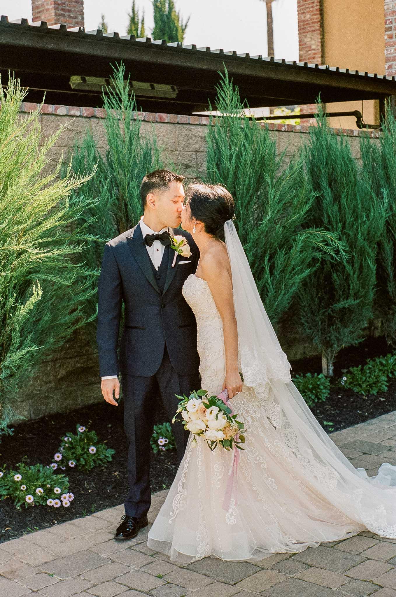 Bride-Groom-Kissing-Outside.jpg