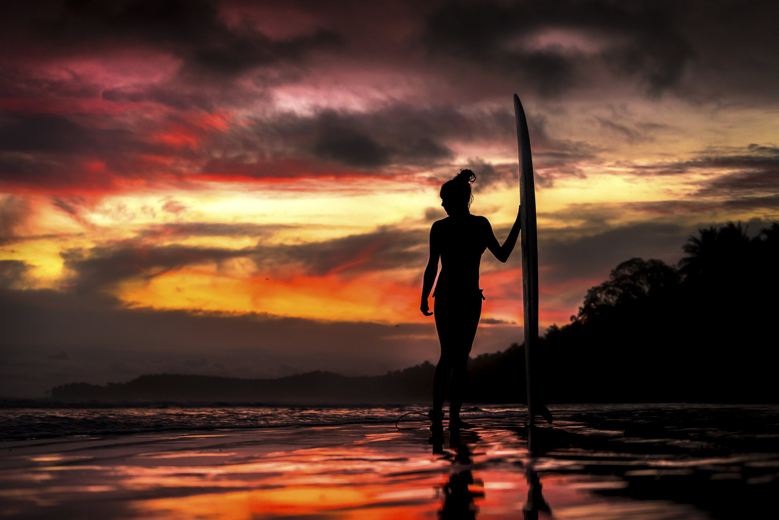Surf girl sunset beach