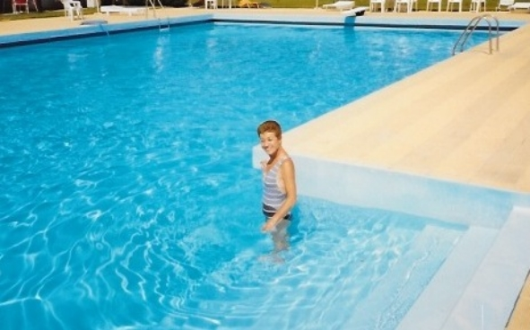 The entire time I lived at home, Mom never ventured farther into the pool than she is there. I finally said to hell with it, she was going to learn, and I taught her to swim over the summer when I was home from school.