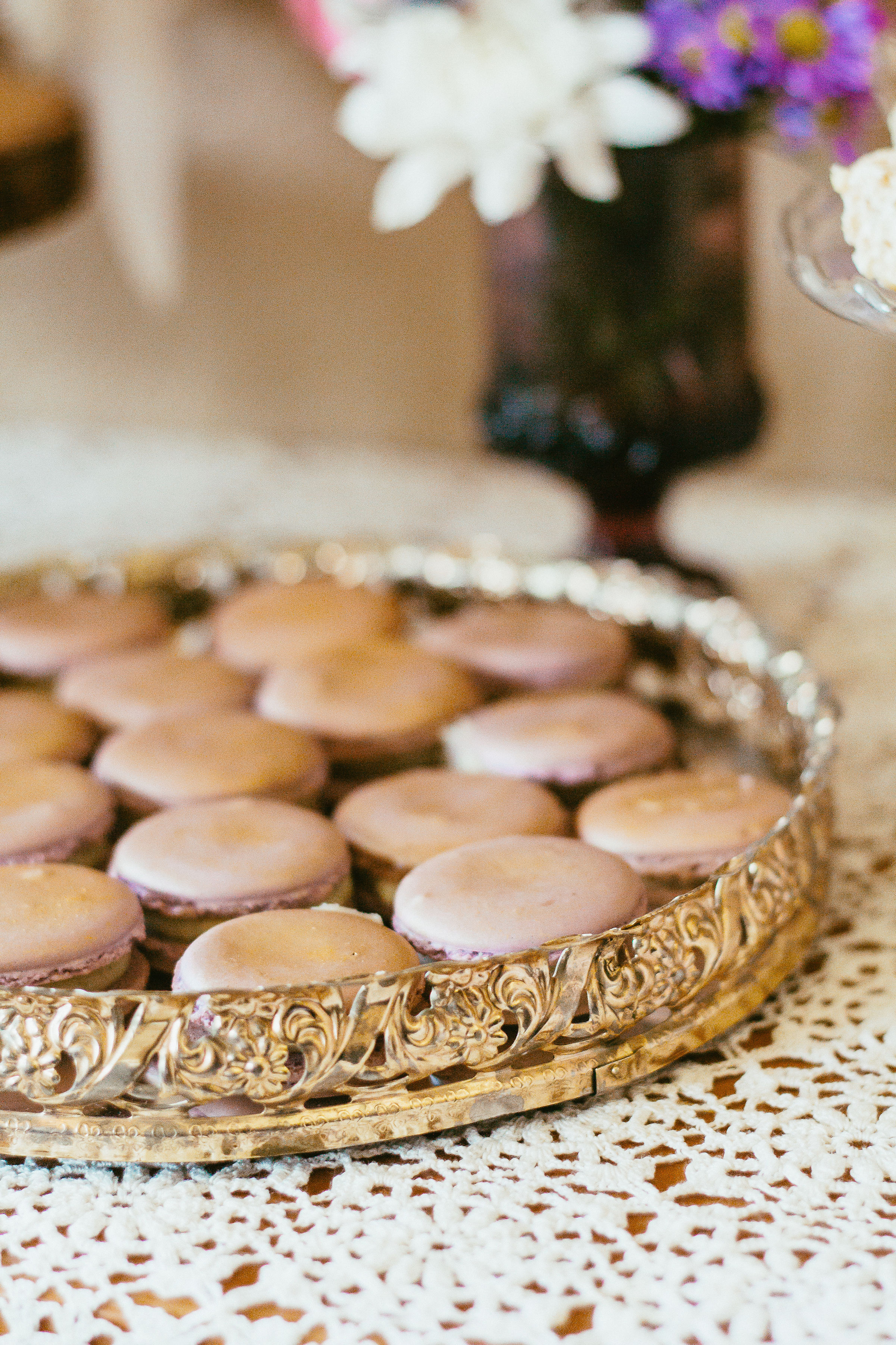 Gold dusted macrons displayed on our round mirrored tray.