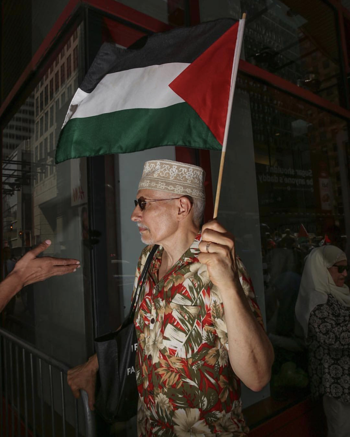 A Muslim man holds the Palestinian flag during a rally and protest in solidarity with Palestine in Times Square, Manhattan, NY, U.S. on July 22, 2017. Pic courtesy: Amr Alfiky