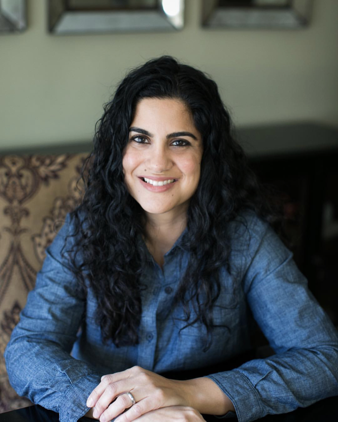 "Hena Khan, a children's book author born and raised in Rockville, MD, poses for a portrait at her home. Among others, Khan has written two books about celebrating Ramadan, ""Night of the Moon: A Muslim Holiday Story"" and ""It's Ramadan, Curious George"". Her most recent book is ""Amina's Voice"", a story about a young Pakistani-American girl. Pic courtesy: Zoshia Minto."
