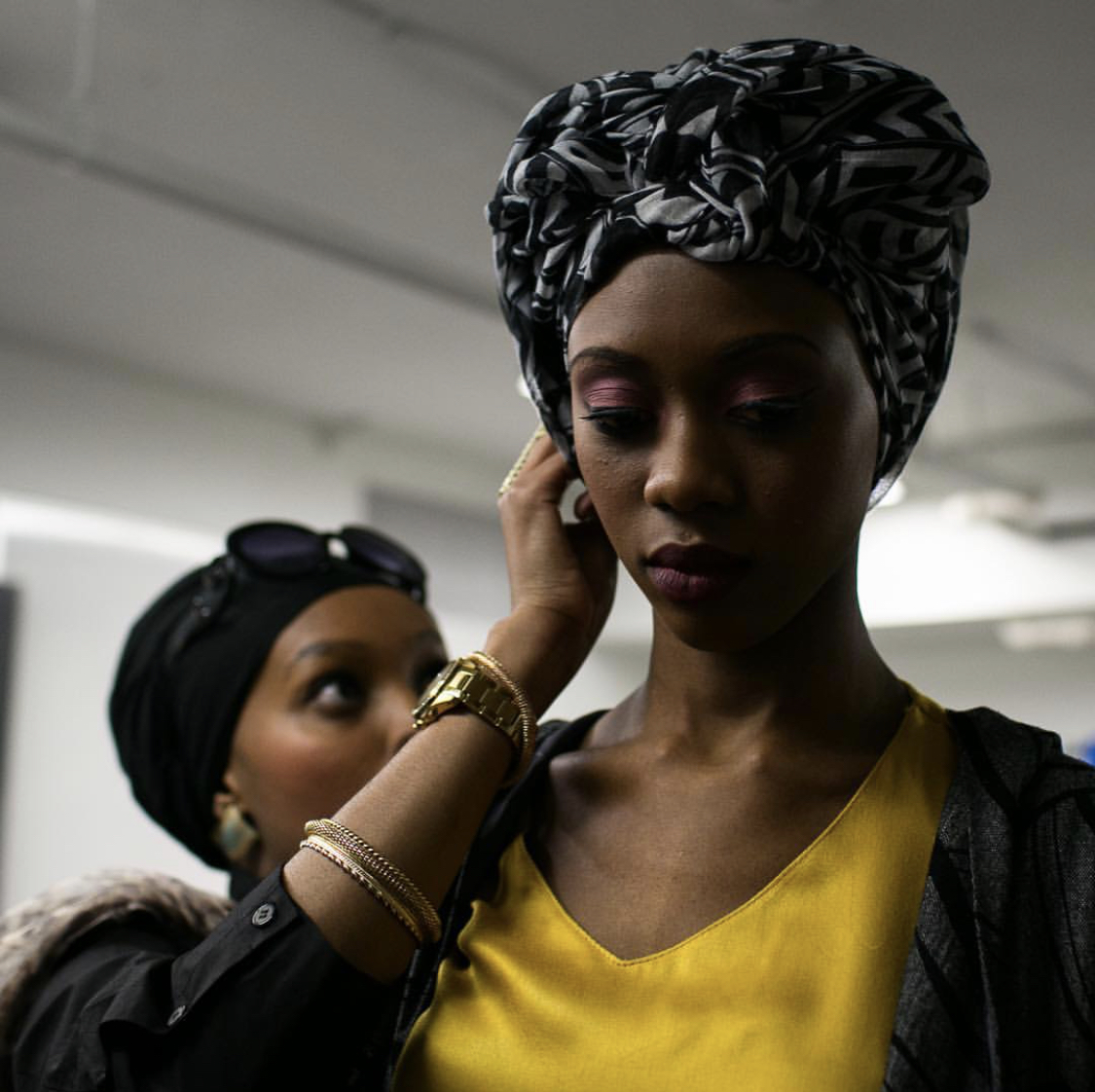 A Muslim clothing designer adjusts the turban on a model before the start of the Haute and Modesty Show during DC Fashion Week in Washington. The show, which was part of DC Fashion Week for its fourth season, featured modest fashion from various local and international clothing designers. Pic courtesy: Zoshia Minto.