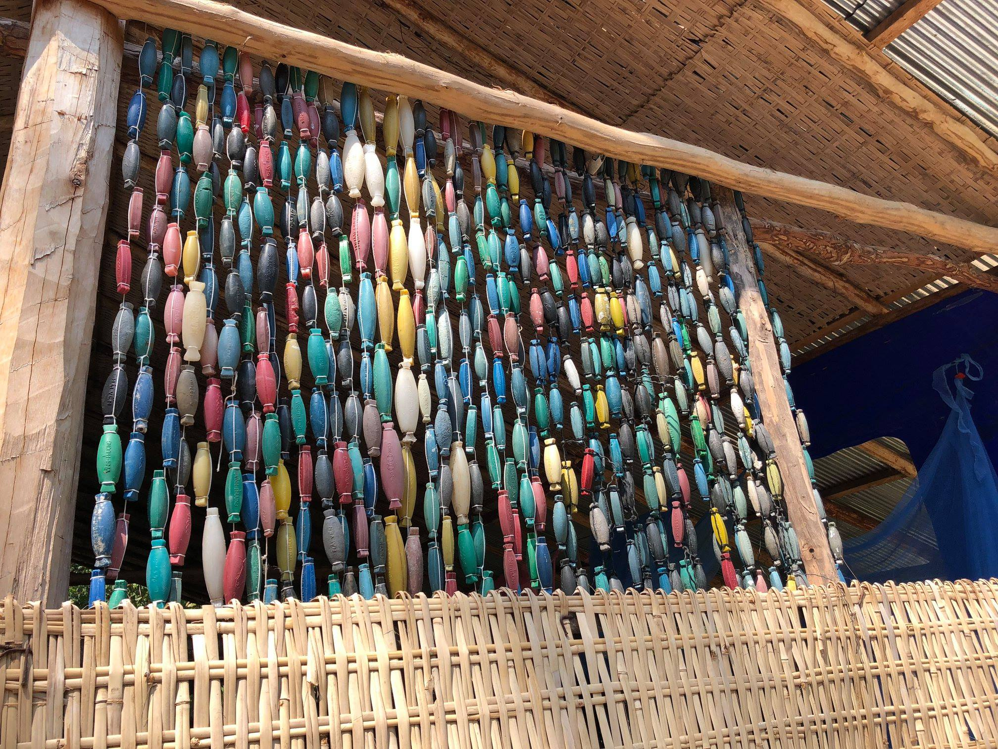 An airy wall made of 473 fishing buoys.
