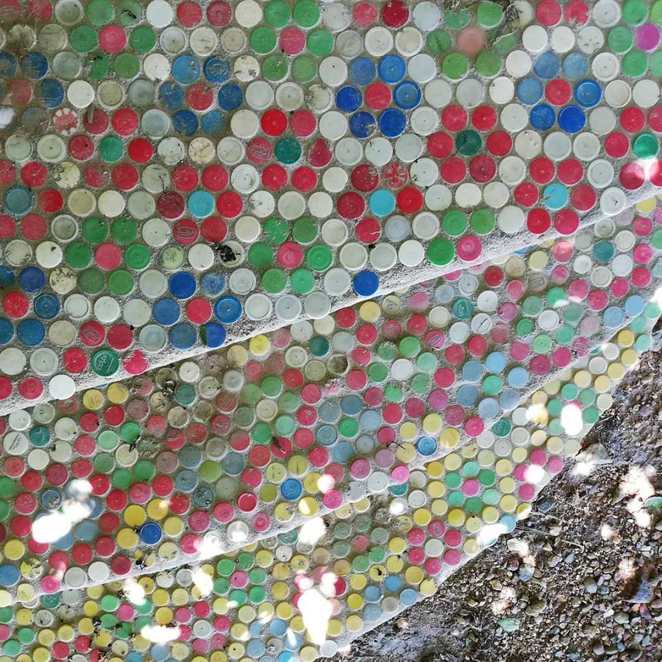 Steps decorated with plastic lids.