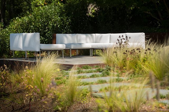 This floating wood deck, with corten steel wrap, is a beautiful place to look out across the Magothy River   _________________________________  Photo by @david.burroughs.54 Builder @pyramid_builders Furniture @janusetcie designed by @Jordan_Loch_Crabtree while @campionhrubyla #landscapearchitecture #minimal #minimalist #design #landscape #garden #gardendesign #architecture #nature #design
