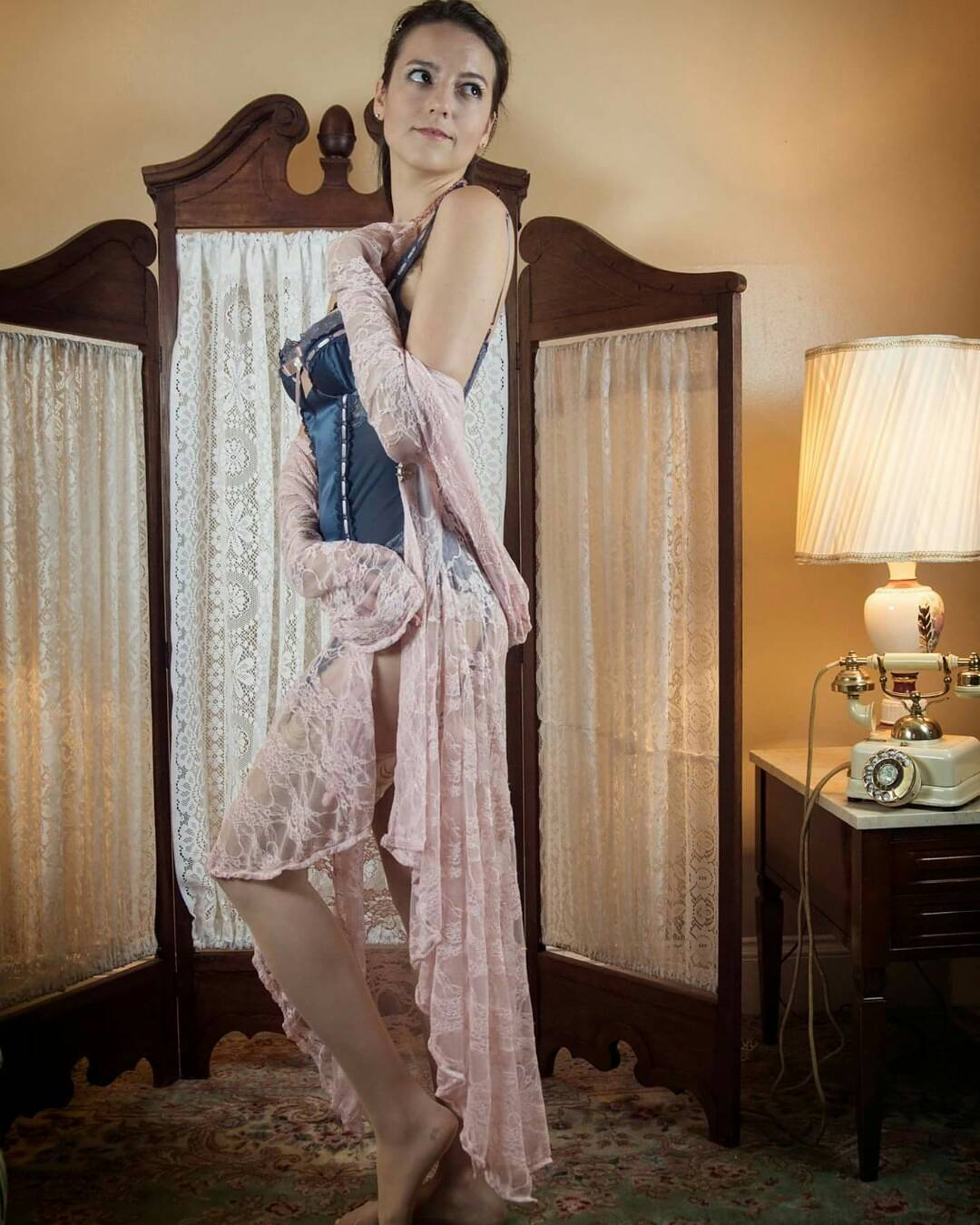 Model wearing lacy lingerie in soft blue and pink colors from the curated collection of VaVaVooom in Asheville NC.