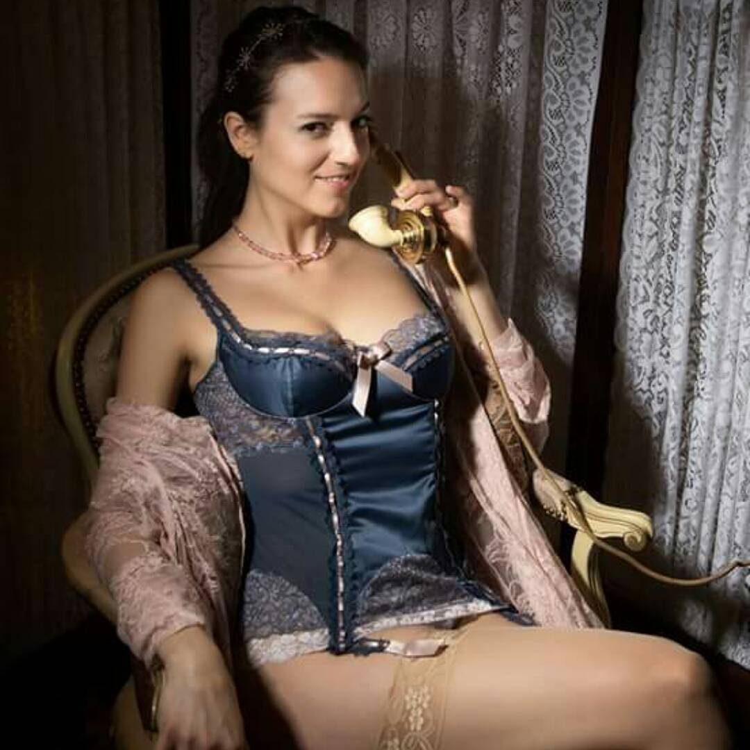 Model wearing soft blue corset and lacy pink negligee from the curated lingerie selection of VaVaVooom in Asheville NC.