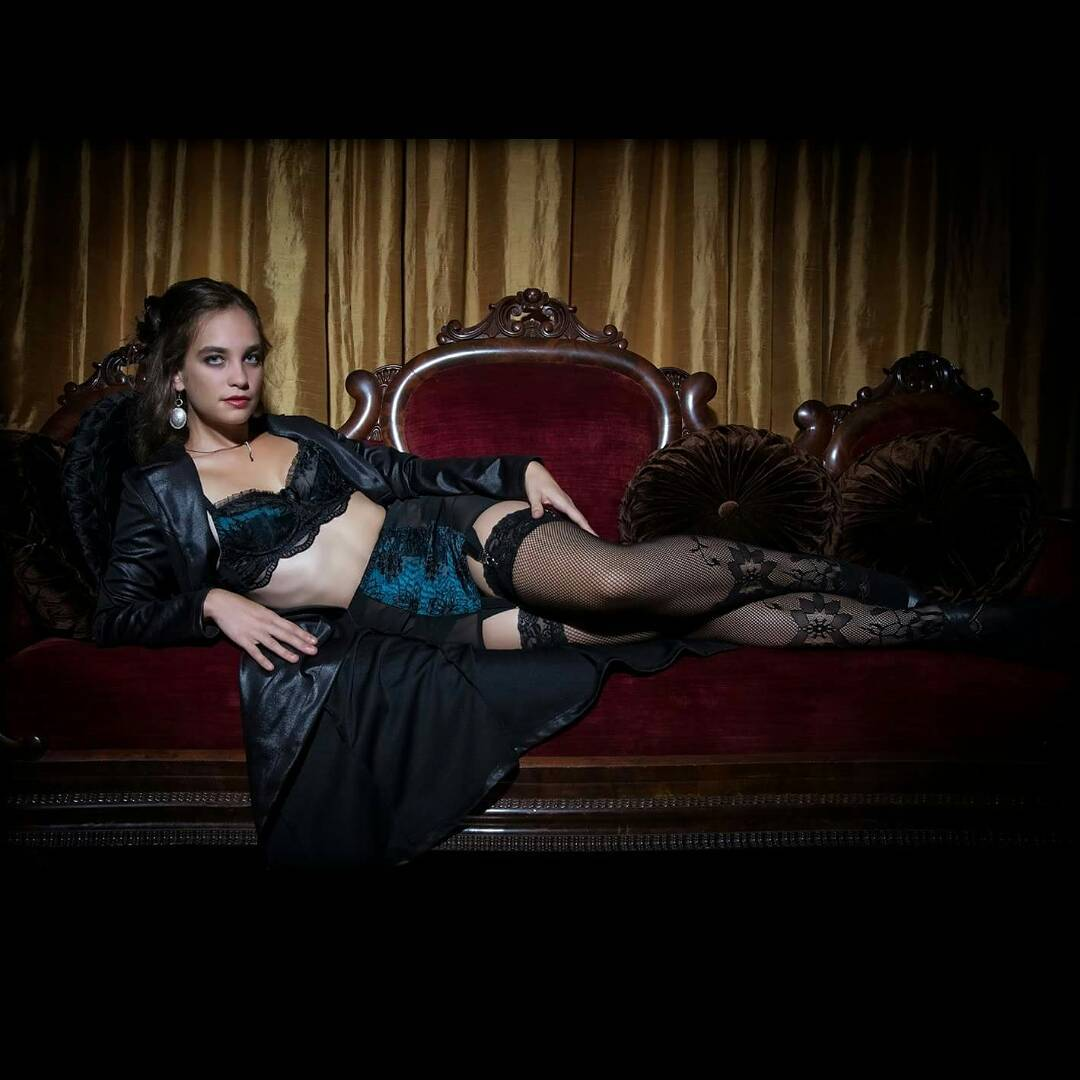 Model wearing black silk robe and dark blue lingerie from the curated collection of VaVaVooom in Asheville NC.
