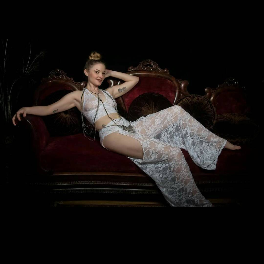 Model wearing lacy white lingerie from the curated collection of VaVaVooom in Asheville NC.