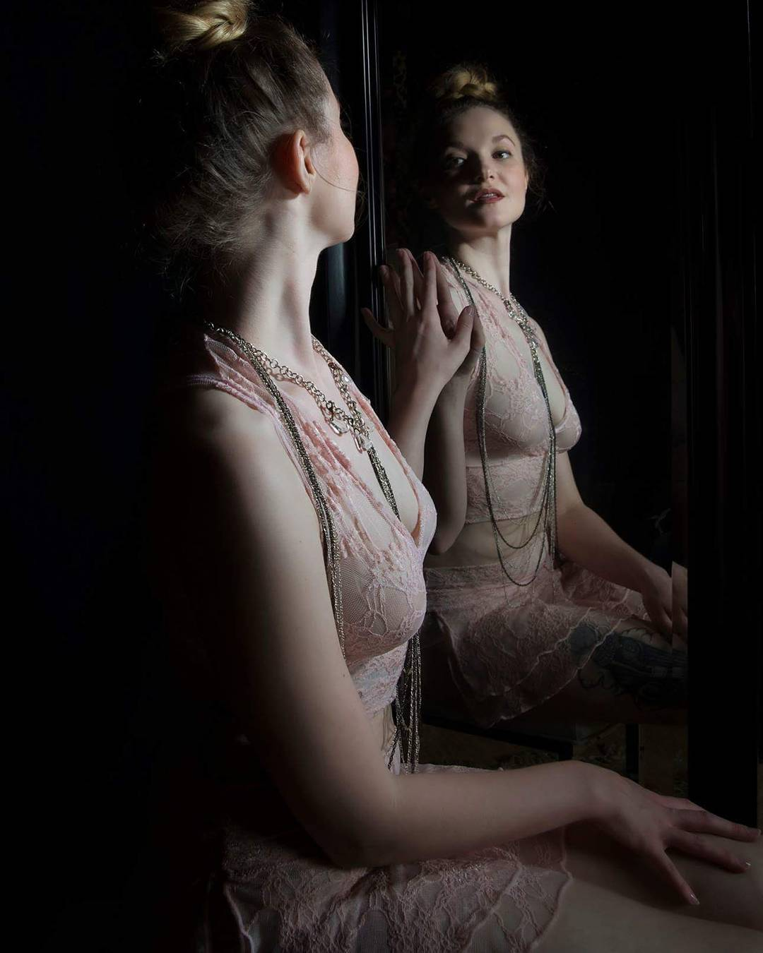 Model wearing light pink lacy lingerie from the curated collection from VaVaVooom in Asheville NC