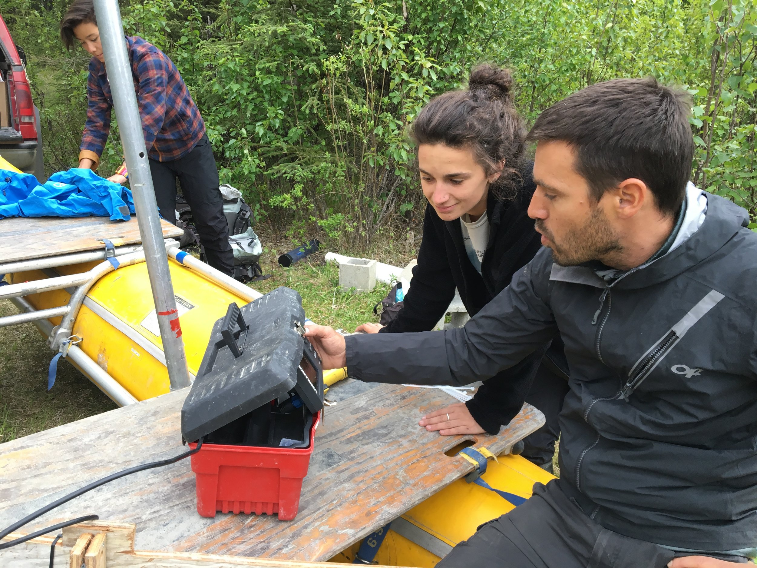 David Fortin and Ellie Broadman getting ready to create a bathymetric map at Sunken Island Lake