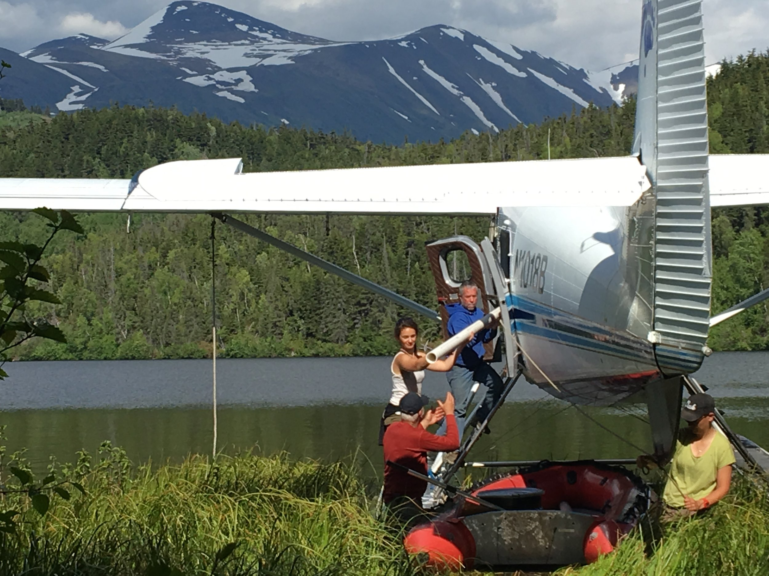 Ellie Broadman, Scott Anderson, and Annie Wong unloading gear from the Otter at Pothole lake