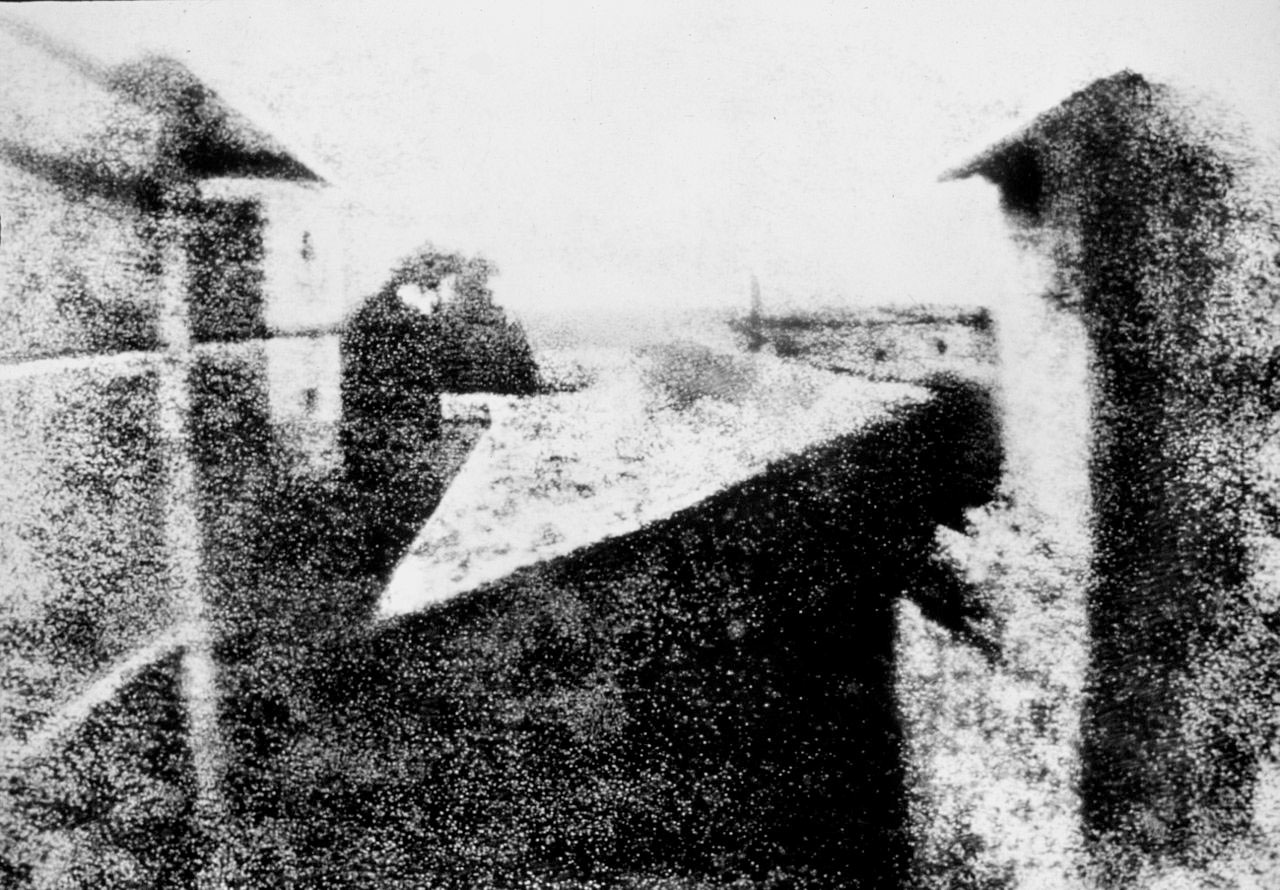 Enhanced version of Joseph Nicéphore Niépce's  View from the Window at Le Gras , 1826 or 1827. Public Domain.