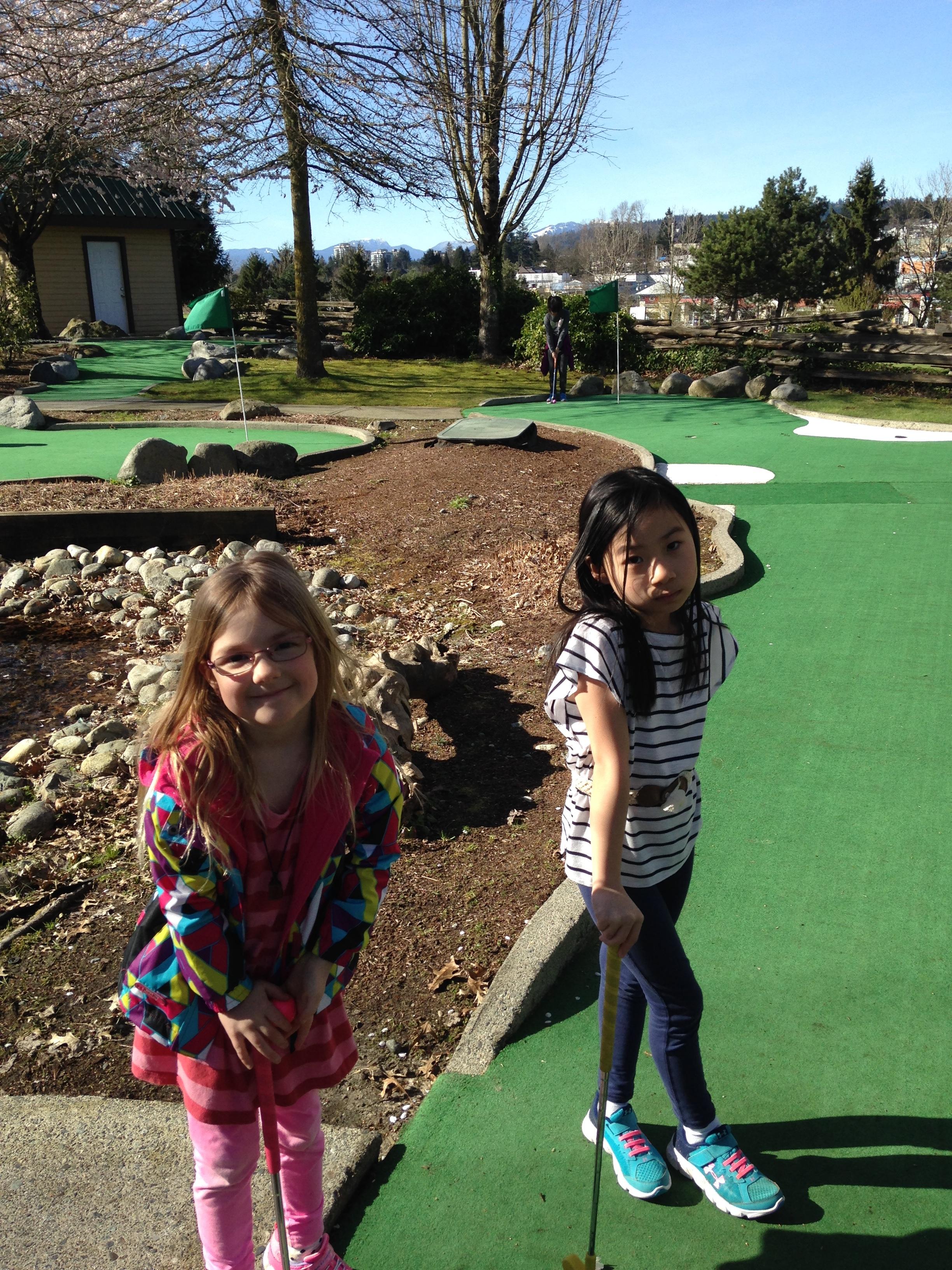 little kids mini golfing.JPG