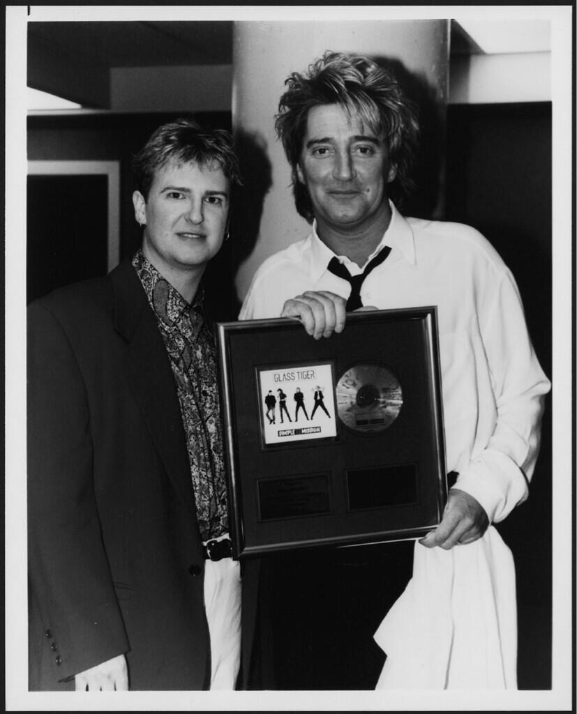 Presenting Rod with an award for Simple Mission, on which we sang MY TOWN together.