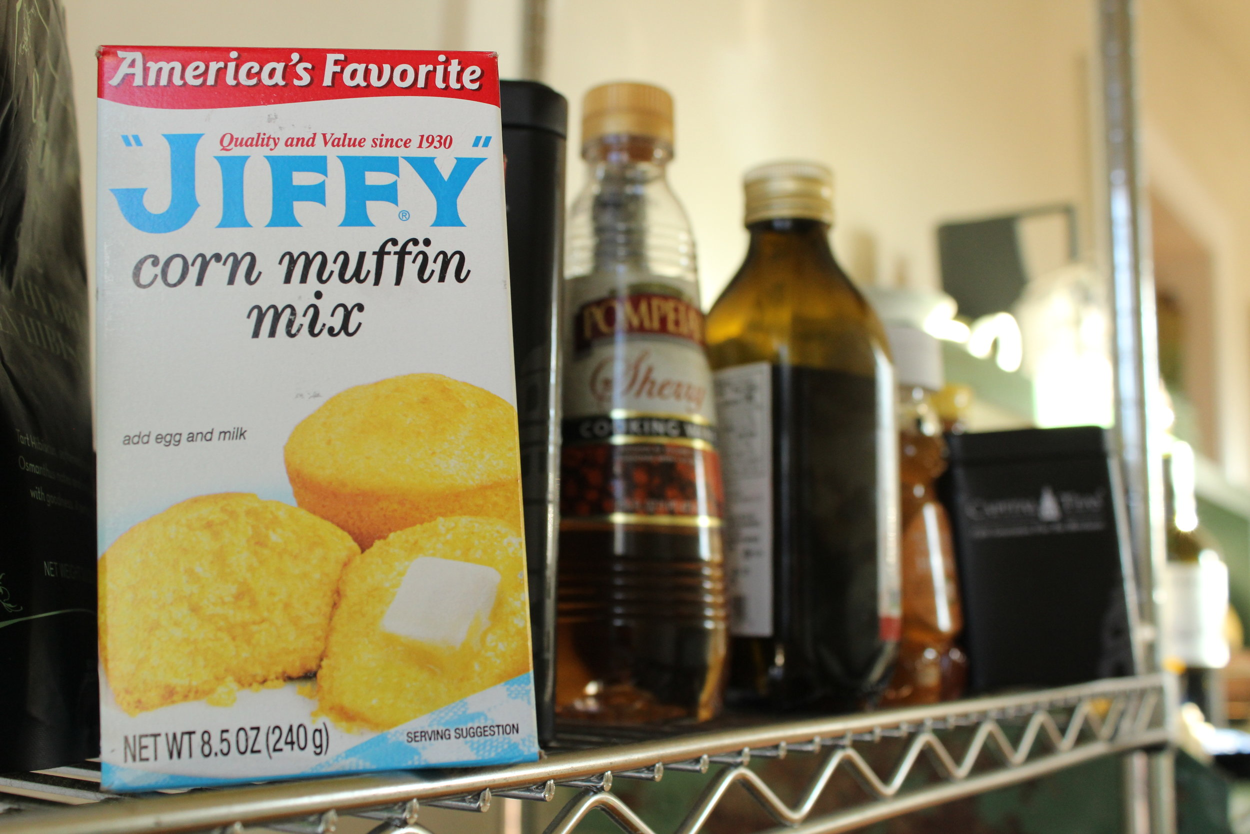 Curry always keeps several boxes of his favorite cornbread mix, Jiffy, tucked away in the kitchen.    Photo elements: selective focus, rule of thirds