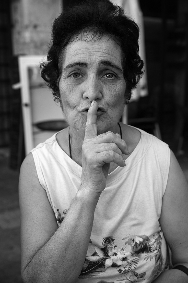 SILENCE PROJECT - This project connects the spectator with individuals brandishing the universally recognized gesture and symbol for silence. It is here where individuals by an independent and voluntary occurrence, find themselves facing the reality of being that is not within the realm of the peripheral. The message by the artist allows us not only to glimpse the external expression of mutism,but it propels this stillness towards the viewer's consciousness,so that all can perceive what each individual irrefutably leaves behind:their inner state of being.