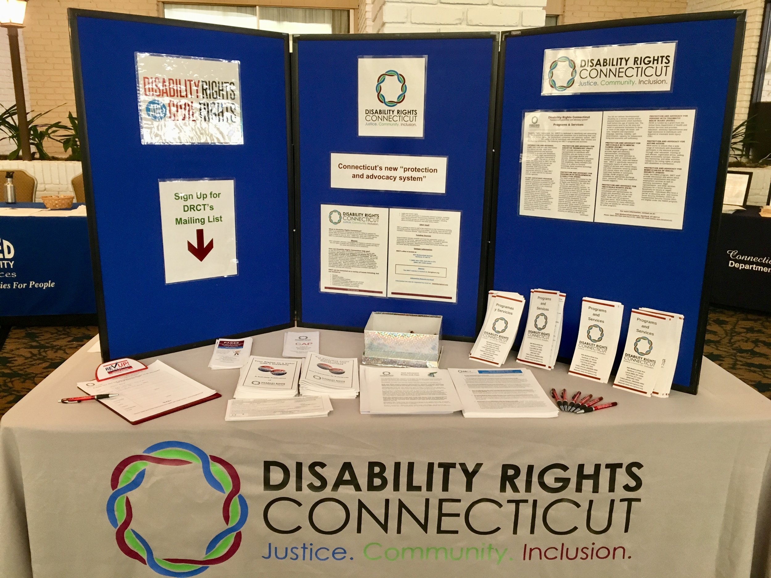 Disability Rights Connecticut's informational booth with PAMPHLETS and flyers at the ACQUIRED brain injury conference.