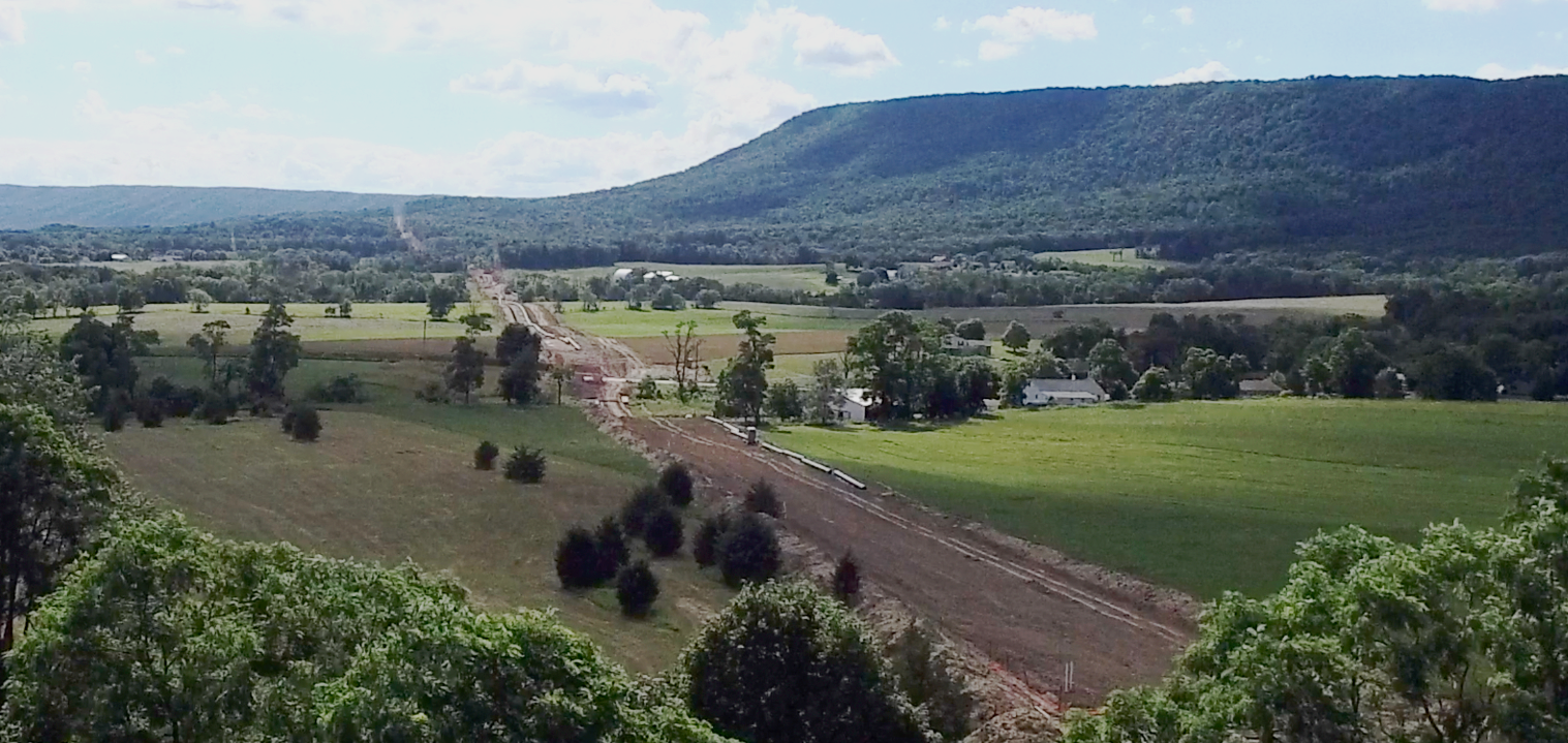 One example among many: the view from 200 feet above the farm of Cumberland County, PA residents Ralph & Doris Blume. Sunoco Logistics/Energy Transfer Partners used eminent domain to acquire land cutting through their home. The corporation was granted public utility status that allowed them to do so by the Pennsylvania Public Utility Commission