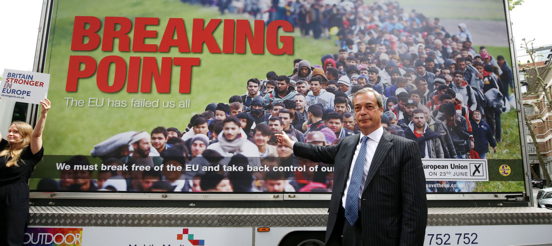 Nigel Farage standing in front of a pro-Brexit campaign poster as a pro-Remain activist waves a sign near him.Credit:PA Images/Fair Use for purposes of comment or criticism