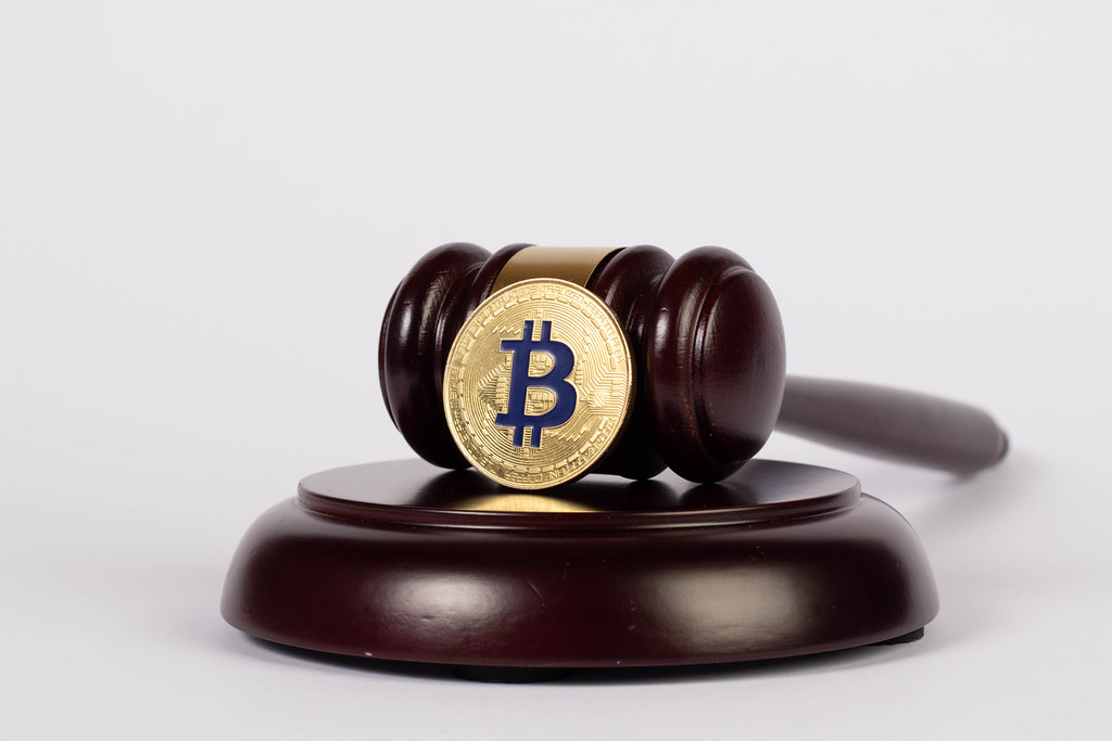 Golden Bitcoin with judge hammer